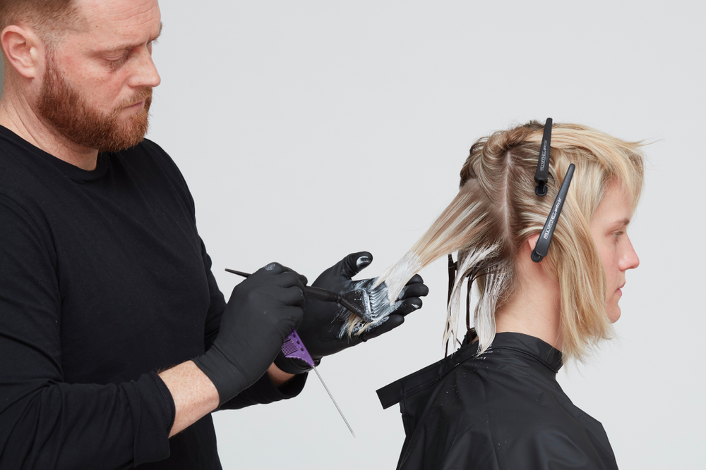 1. Start in nape. Take ½-inch slices from an inverted V section. Using Paul Mitchell Skylight lightener with 40-volume developer, paint the ends