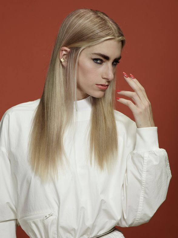 """Model Sasha arrived with dramatic new growth and faded lengths. """"Our goal with Sasha was to create a dusty rose blonde,"""" Blackwell-Preston says. """"When doing corrective work I like to lowlight in between every third foil for added dimension."""""""