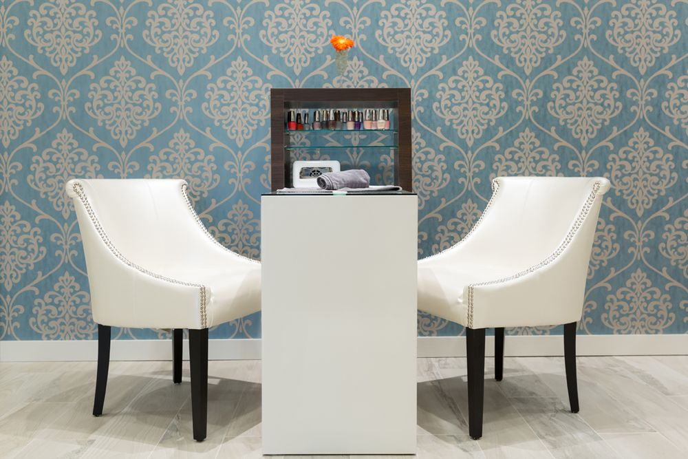 Wedgewood accent walls soothe clients in the manicure area.
