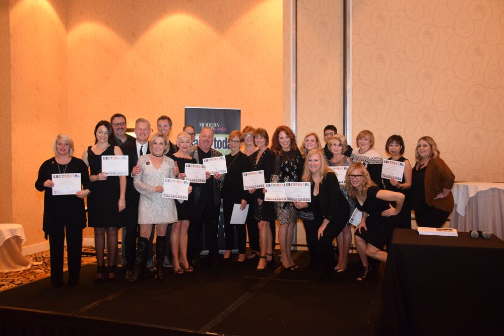 Fourteen salons collected 10-year certificates (for being named to the competition 10 years or more) at the special 20th anniversary celebration.