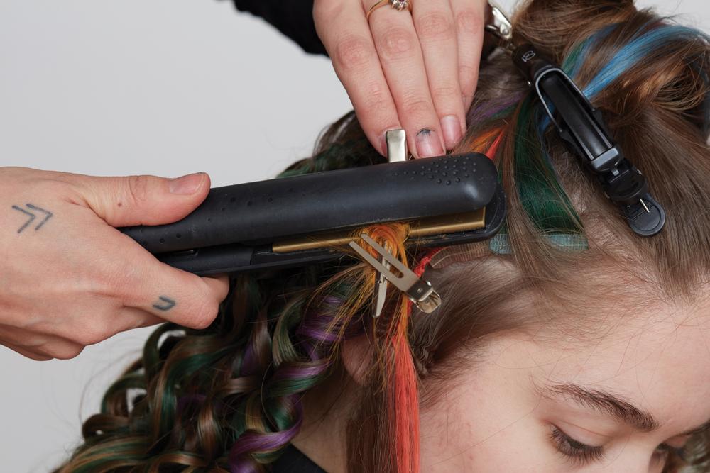 STEP 11. Press with a flat iron. Allow to cool. Style as desired.
