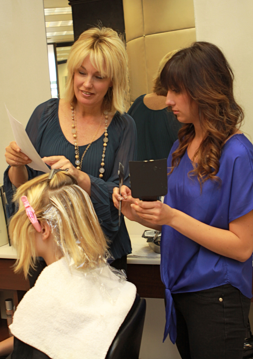 Candy Shaw Codner trains a colorist at Jamison Shaw Hairdressers in Atlanta, Georgia.