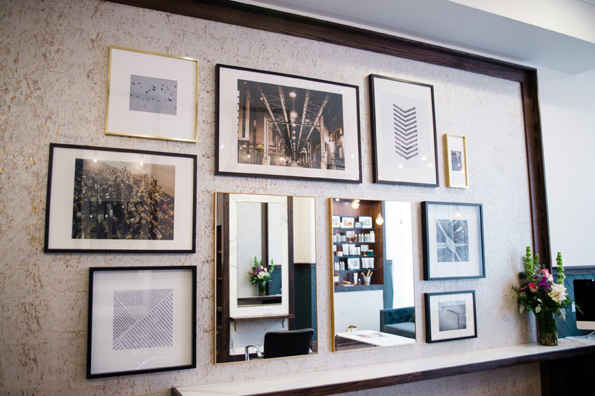 Framed uban photography graces the walls of Base Salon.