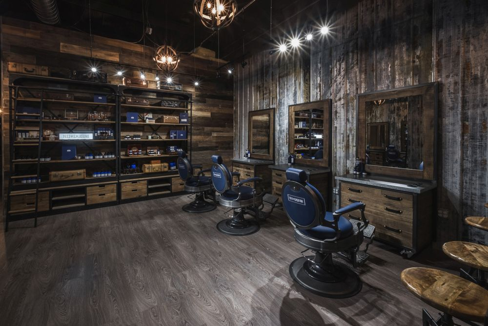 <p>Although the interior of 1922 Men&#39;s Grooming Salon is all rustic, manly blue chairs echo the look of the packaging of the 1922 by J.M. Keune line.</p>
