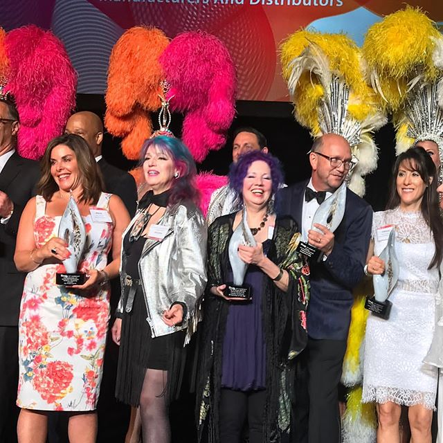 Manic Panic's Tish and Snooky (center) receiving the City Awards 2017 for Industry Contributor Entrepreneurs of the Year at Cosmoprof North America in Las Vegas. Photo courtesy of @manicpanicnyc on Instagram.