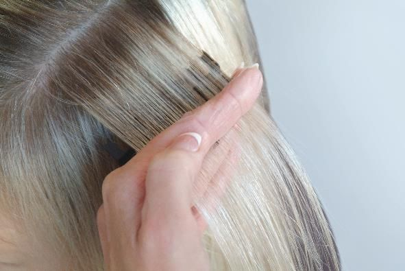 <p>Turn the wrist, tilting the Weaveze towards you. Use a pin tail comb to insert in between the layers of the separated hair created by the weaving teeth. The top layer will produce evenly spaced weaves ready for color application.</p>