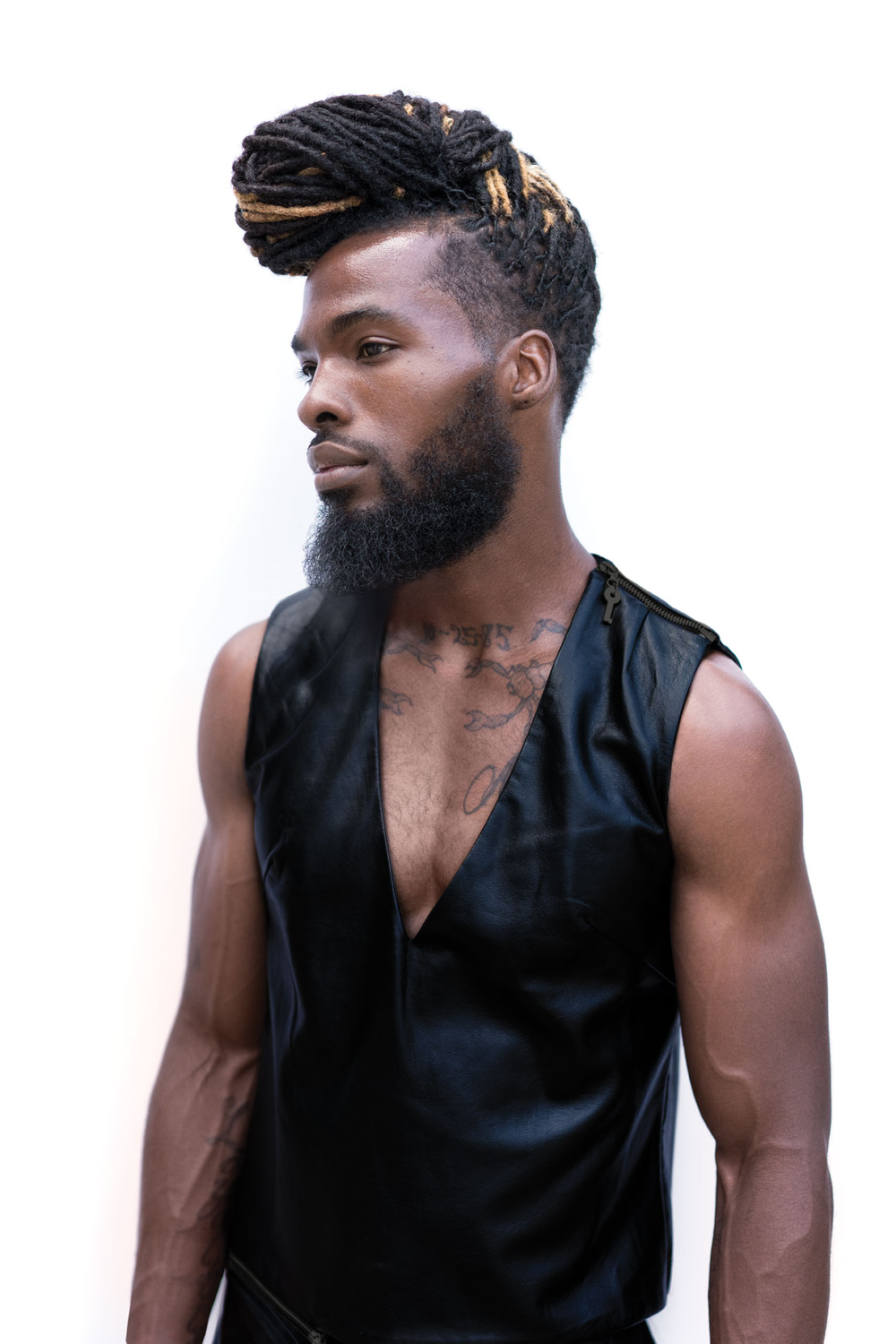 BabylissPRO designer Miranda Phipps braided the model's natural locks and tapered the sides with BaBylissPRO fx880 clipper, then lined him up with the Volare x2 trimmer. The look was sealed with Aquage Beyond Shine and diffused with the Rapido dryer.