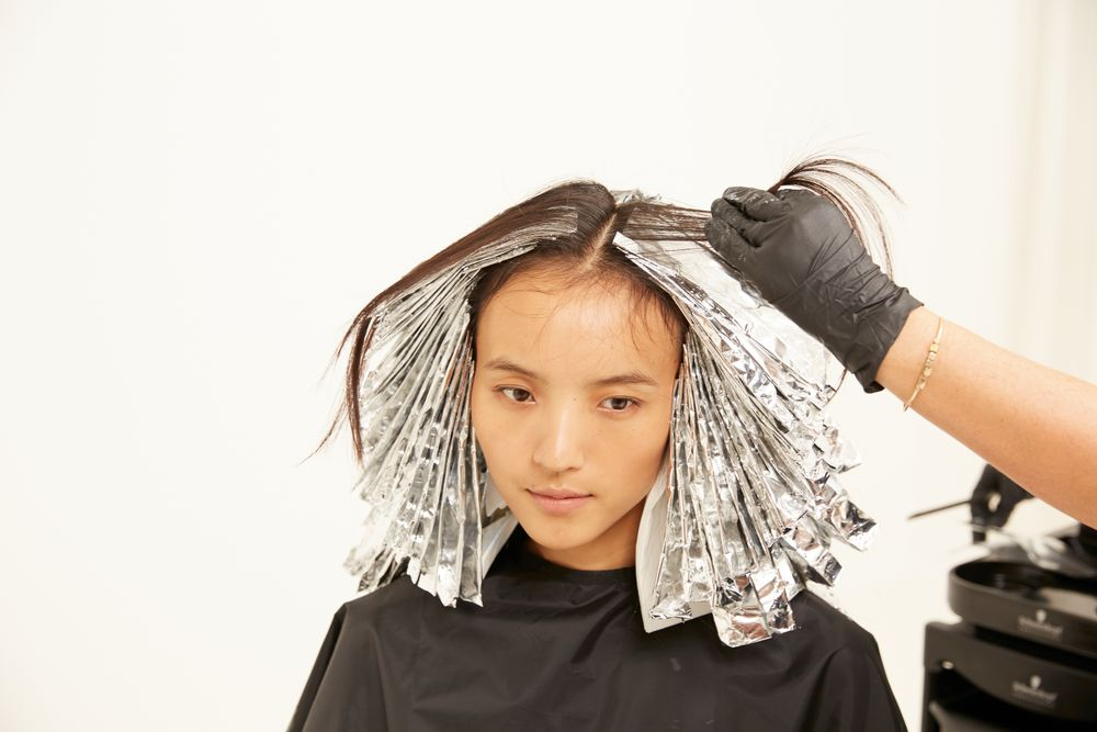 Apply color 2 at the root area. Rinse, shampoo and condition.