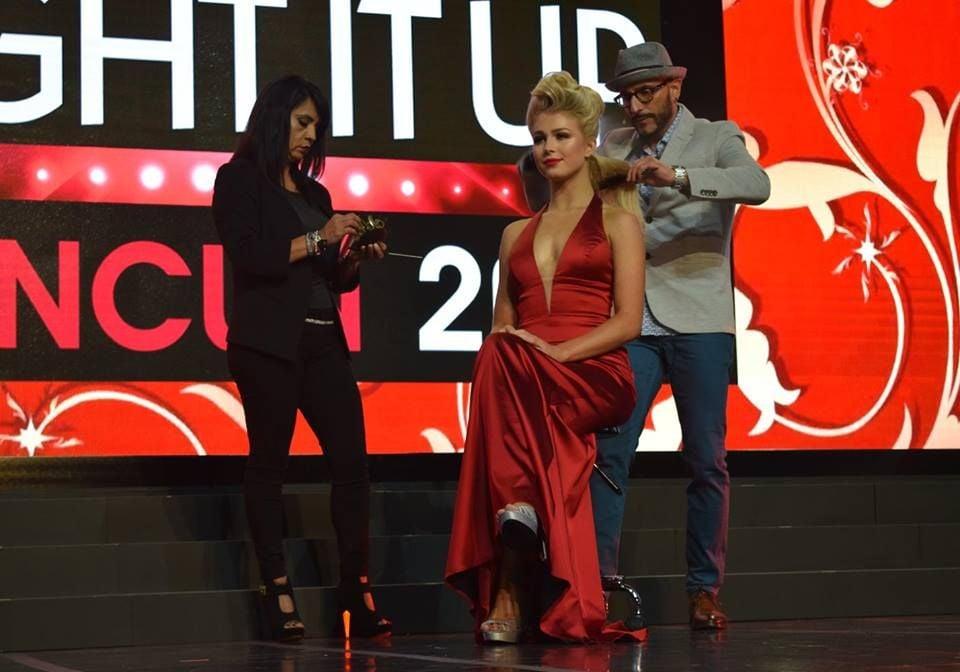 Rocky Vitelli styles hair during the Royal Treatment segment of the gala.