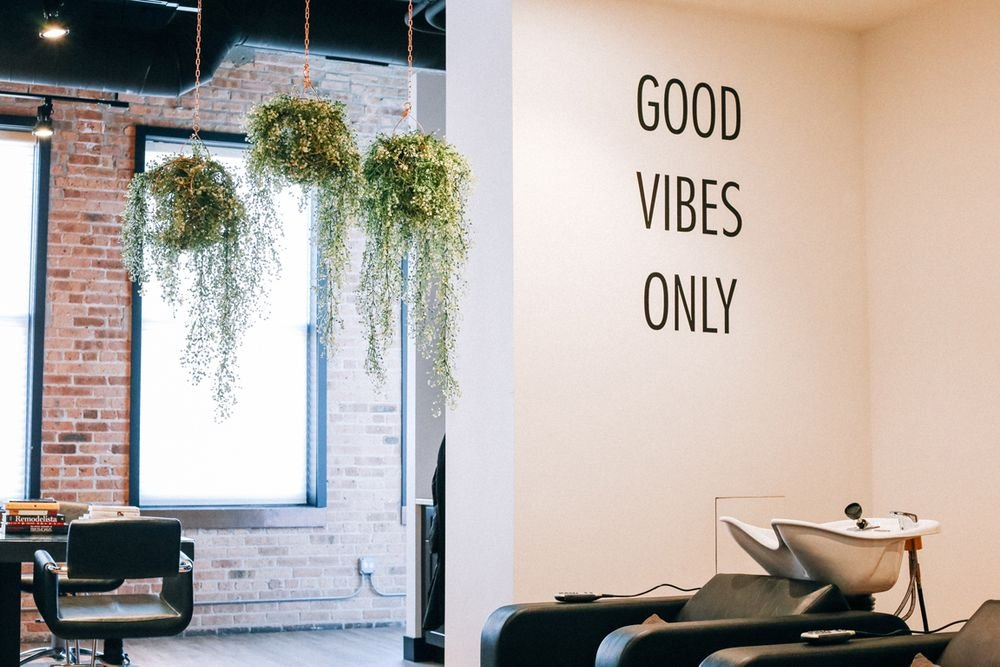 Messanging on the shampoo walls encourage clients on a positive journey.