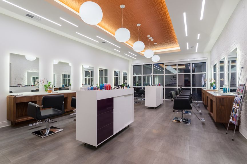 A tray ceiling with inset copper detail adds warmth and interest to the salon floor.