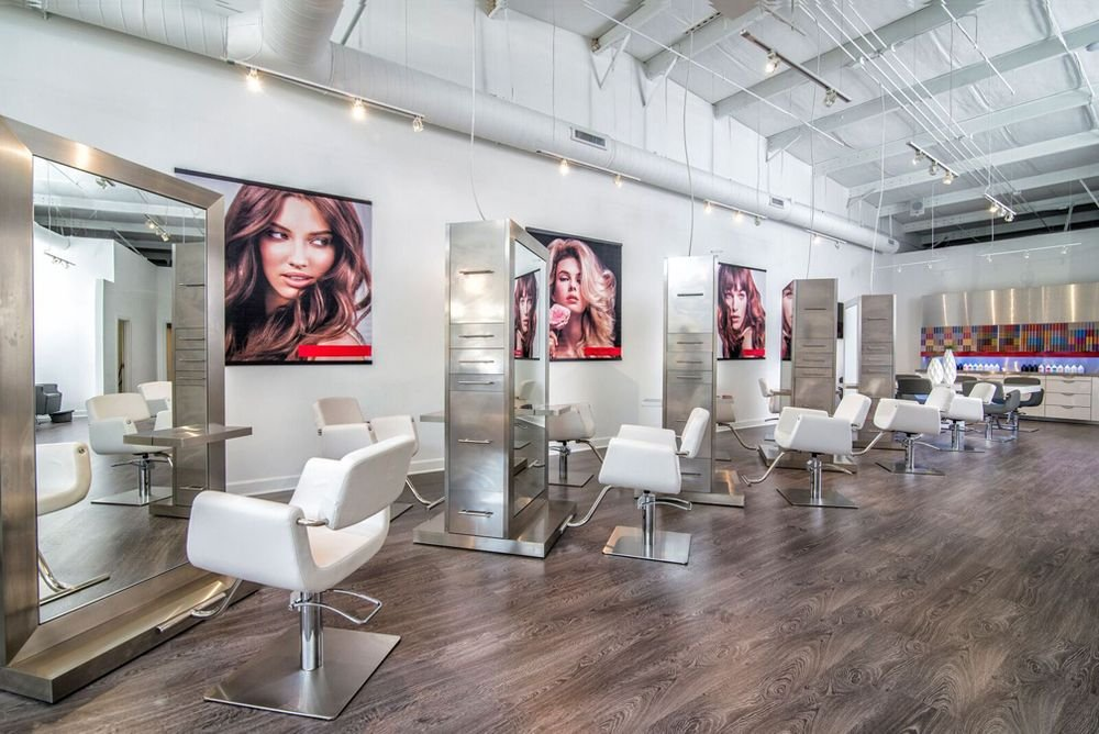 The salon floor is white and bright, putting the focus on the client.