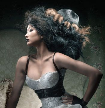 Vintage gowns were custom-accessorized, and paired with ultra modern hairdressing techniques. Hairpieces and extensions were preset, and all hair prepared and finished with KMS California products.  <i>New Moon Knots</i>