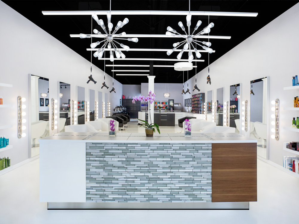 Salon Audace in Norman, Oklahoma, utilizes bright white floors and walls to contrast with the ceiling.