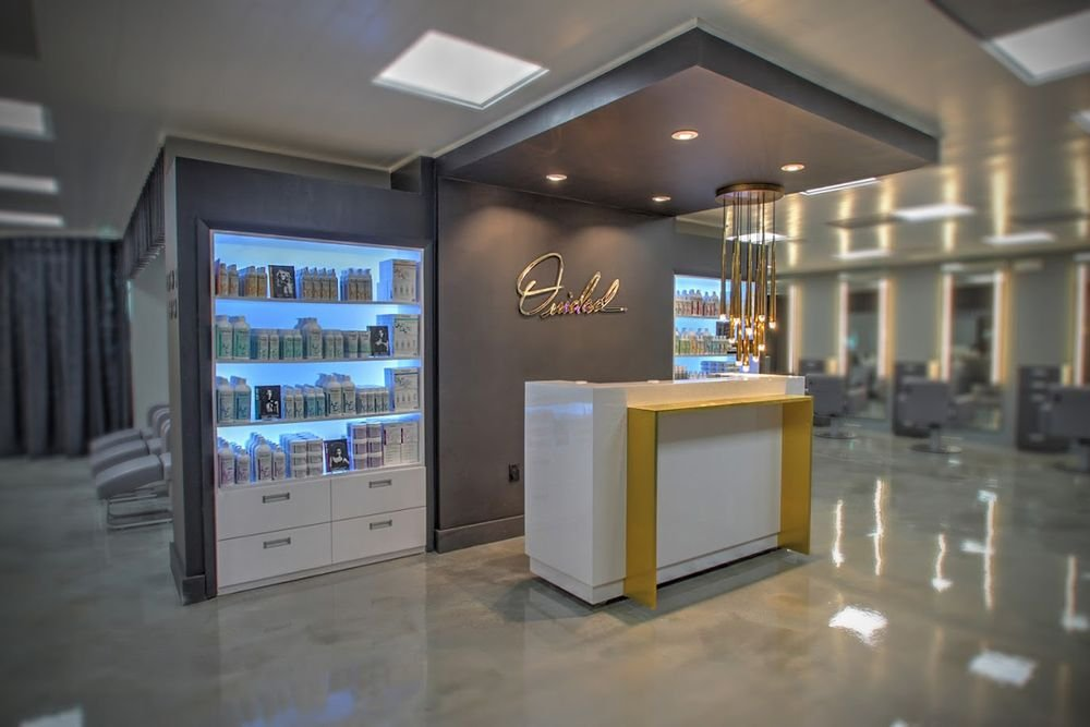 The front desk has recessed wheels and can be moved to accommodate events or education. The built-in retail units are backlit with LED allowing for color changing lights for any mood or season.