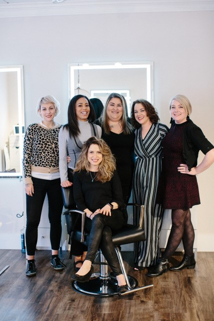 <p><strong>Anna Walsh (seated with her team) says her business has grown 35 percent since working with Salon Cadence.</strong></p>