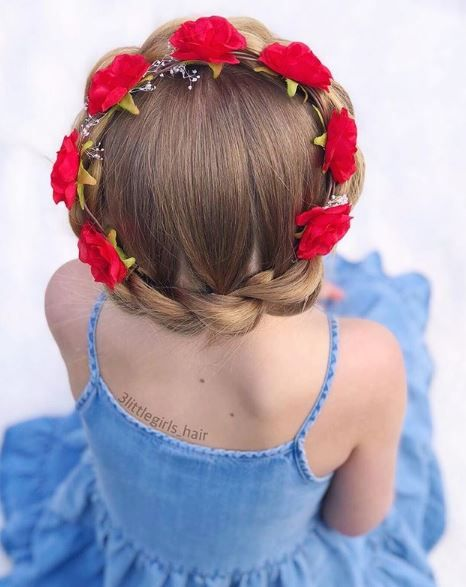 Ring-around-the-rosy, and you'll get a style as beautiful as this one from @3littlegirls_hair. We love how this look merges a grown-up updo with the playfulness of a princess.