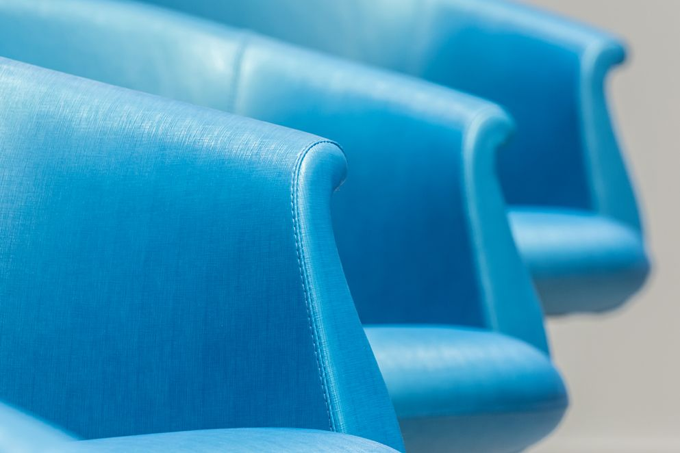 Teal blue chairs at the blowdry bar.