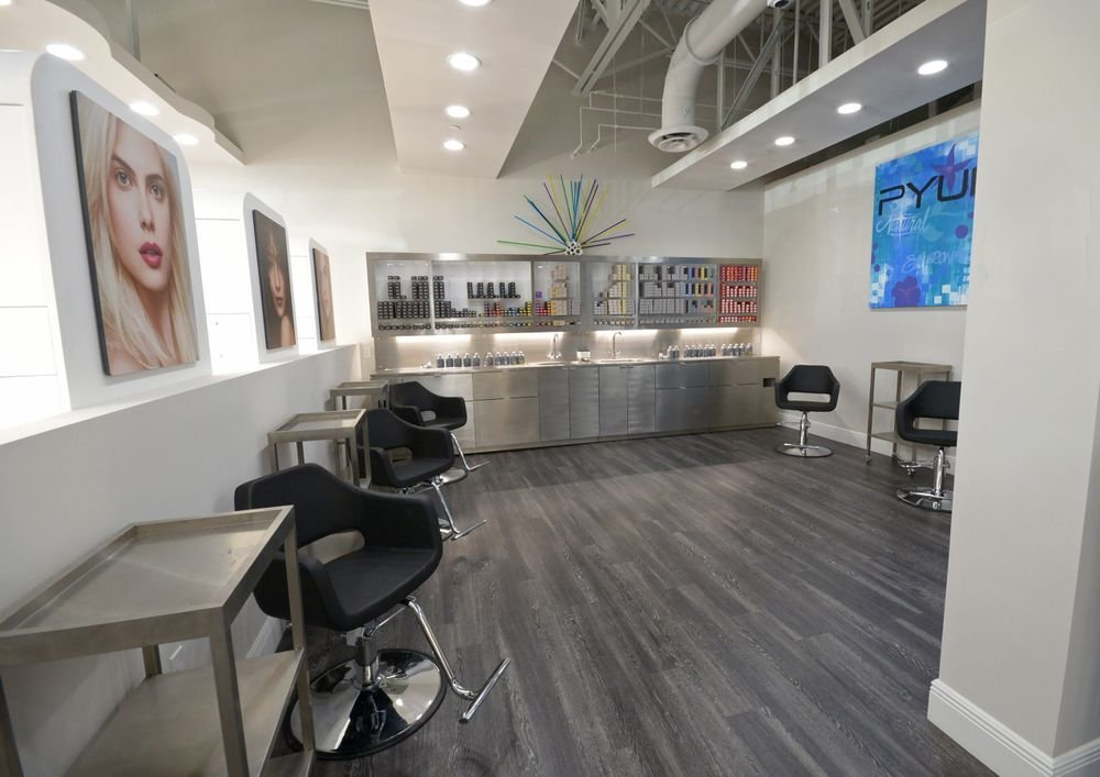 At Pyure Aventura, guests are immersed in retail space as they receive their services, like here at the color bar, giving them the opportunity to test and play with various products.