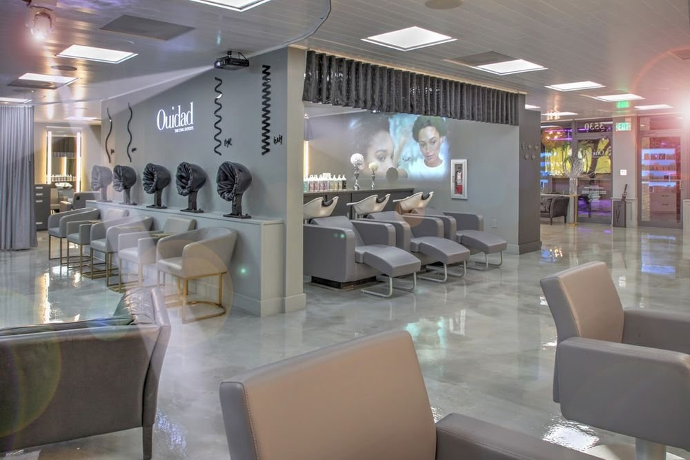Projectors in the shampoo area display an array of images or videos depending on the mood the owners want to set.