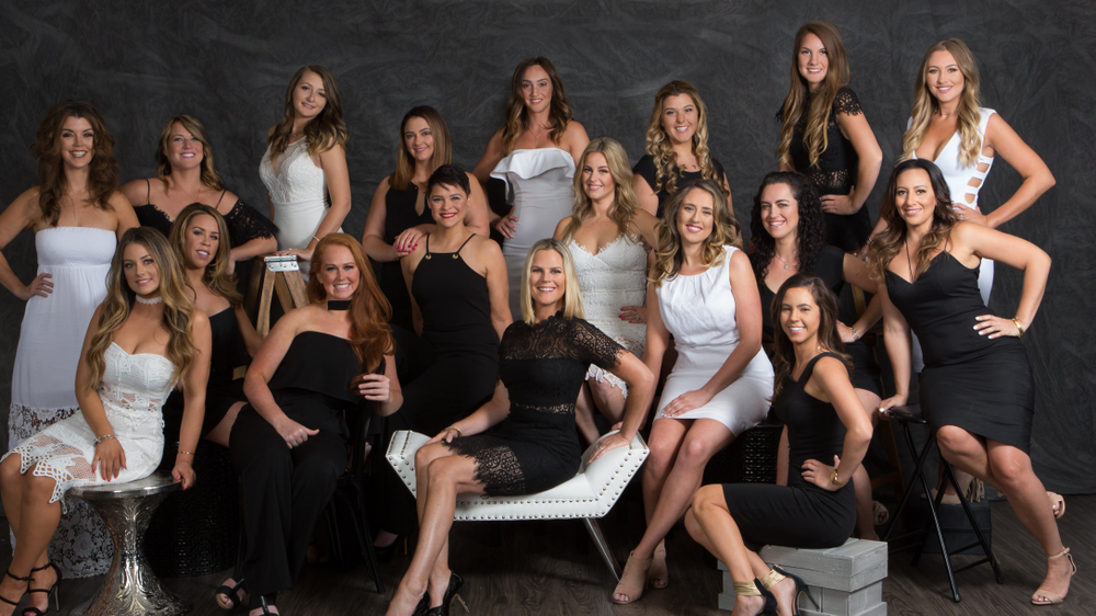 <p><strong>Shelley North (seated, center, shown with her team) benefitted from many of Salon Cadence's turnkey offerings, like a complete hiring manual. </strong></p>