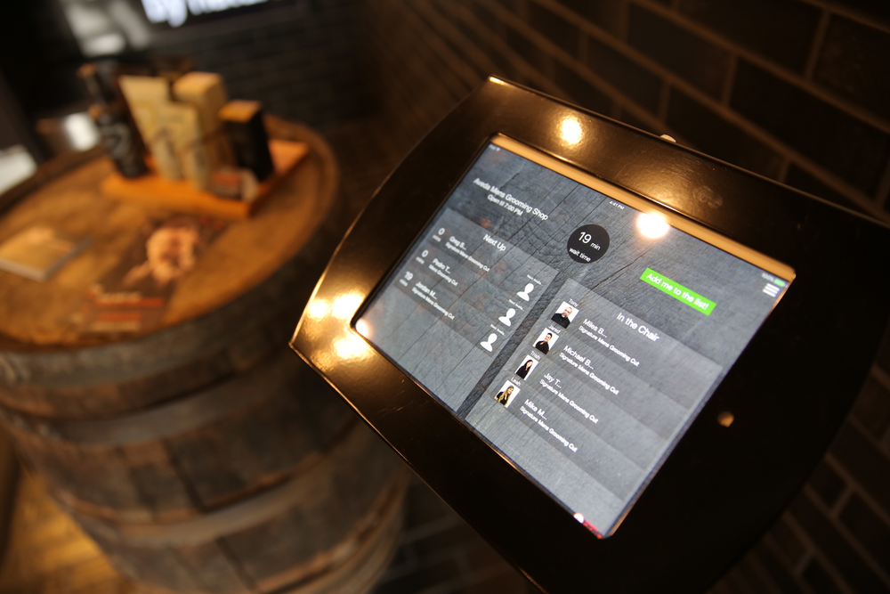 iPad kiosks at the front and back of the salon allow clients to check in, look at wait time and see which stylists are available. Once checked in, clients can monitor their place in line and receive a text when it's time for their appointment.