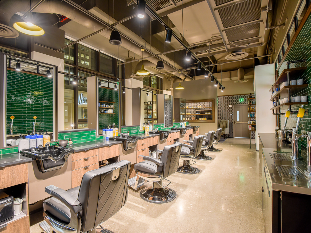 Shampoo bowls integrated into the stations help barbers offer hot shaves in the men's salon, which has a separate entrance than the salon.