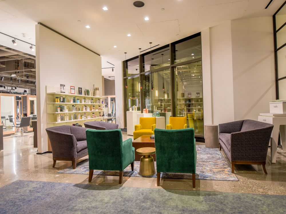 Burrows likens the reception area to a high-end hotel, luxurious but with the durability to handle a large volume of traffic.