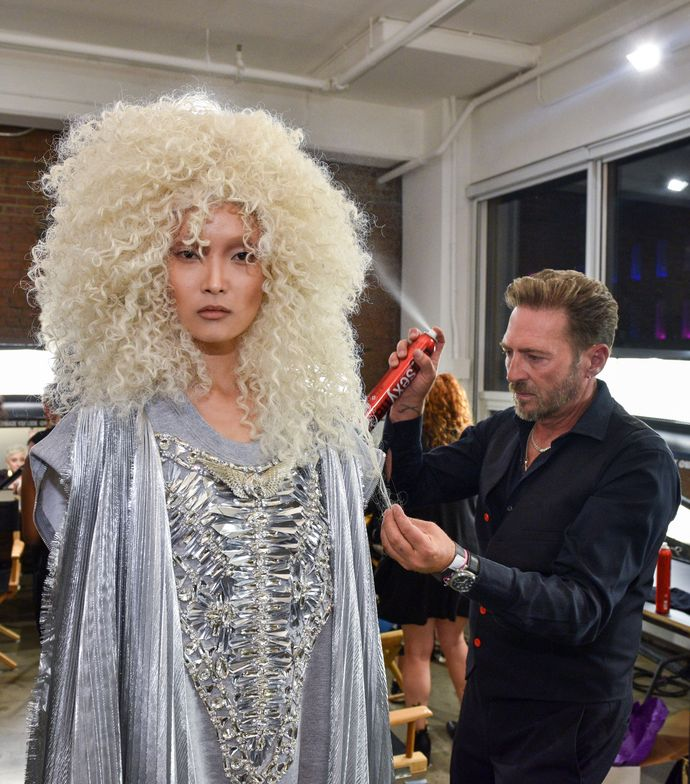 Rafe Hardy puts the finishing touches on a wig for The Blonds S/S '17 collection.