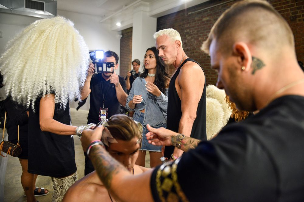 David Blond checks on wig prep before the show.