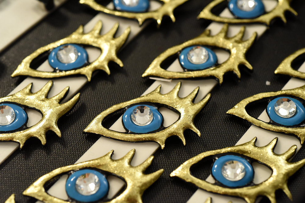 The CND Design Lab team hand-sculpted 180 eyes in various sizes then painted the eyes in vibrant color combinations.
