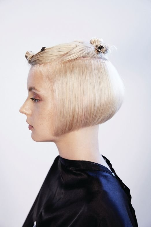 <p>Blow dry hair using a flat brush in natural fall. Using the back-perimeter line as your guide, continue cutting this solid line through the sides. Release the tension and cut the line resting blades against the comb to allow for ear protrusion.</p>
