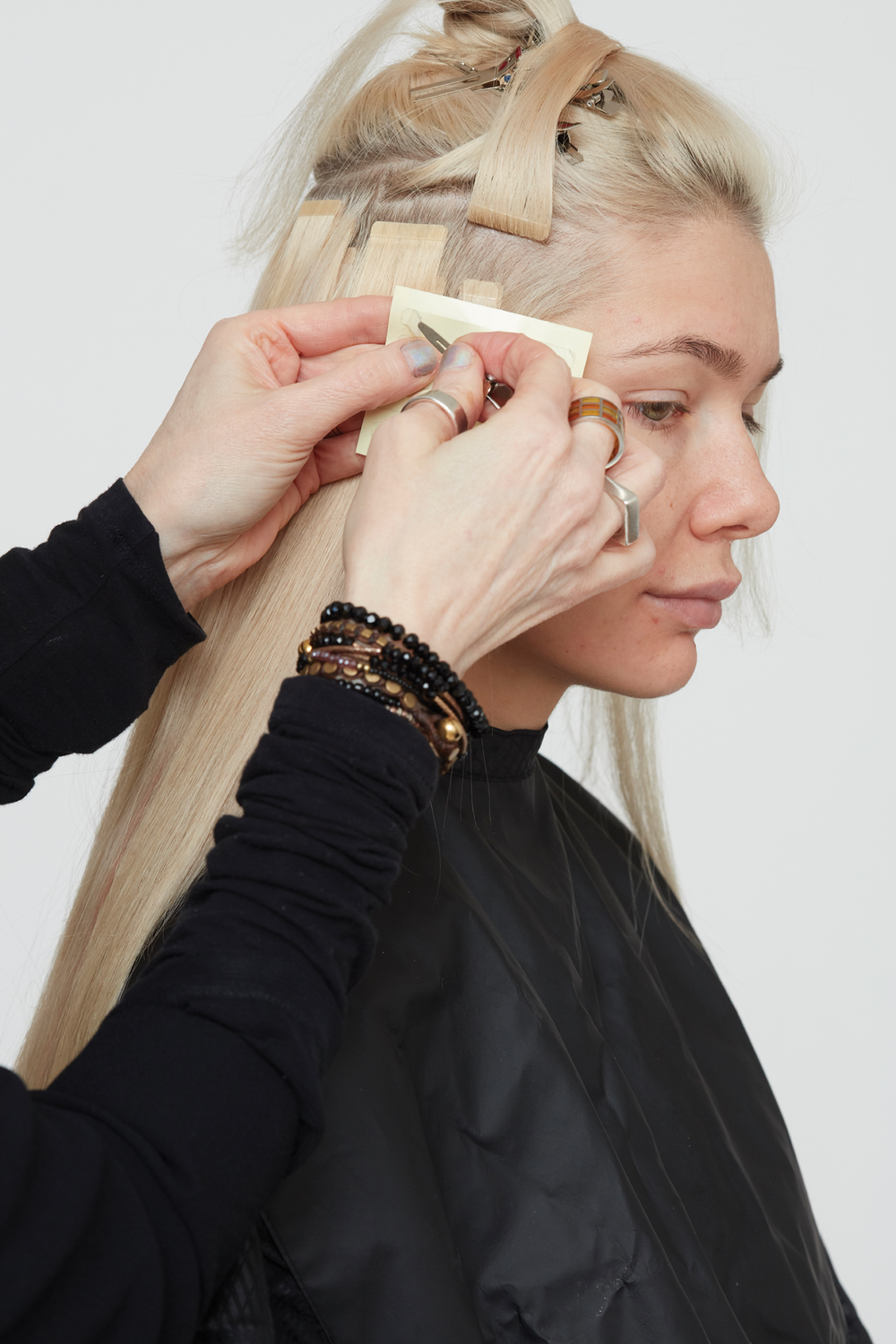 STEP 8. Use smaller extensions in the temple area. Do not go too close to the hairline to allow client to have different style options. In low density areas, GL Tapes may be applied singly with a safety band on the underside of the attachment.