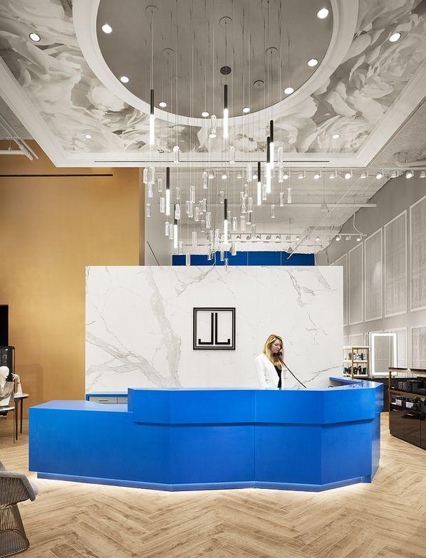 The contemporary cobalt stone reception desk makes a first impression.