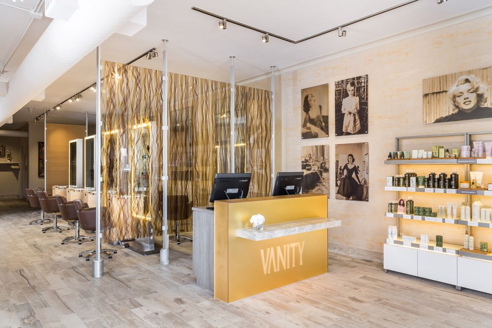 The Vanity logo is engraved on the front desk with lights that shine down on it, so it's highlighted druing the day and glows at night.