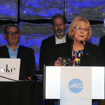 Sally Samuels accepts the N.F. Cimaglia Award at the AACS convention in Orlando, Florida.
