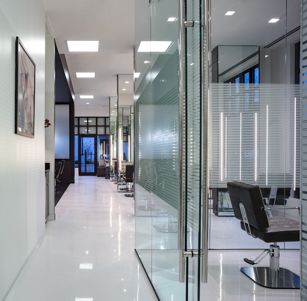 The keratin room is encased in glass, keeping the design open while offering guests a sense of privacy.