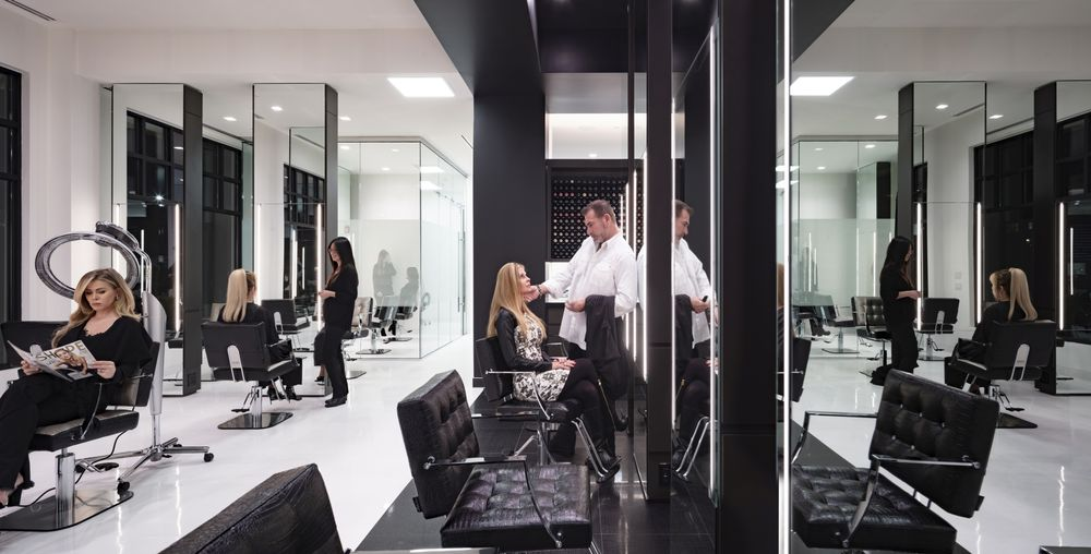 <p>Higher energy areas like color and cutting are separated from the lower energy areas, like the shampoo room and the nail area.</p>