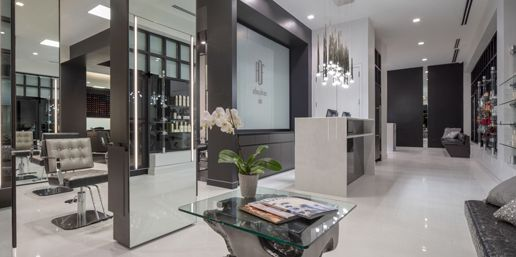 <p>An onyx reception desk under stalactite pendant lighting greets guests to Anthony DeFranco Salon and Spa.</p>