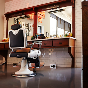Two barbering chairs, oak stations, and American Crew imagery set a distinct masculine tone in...