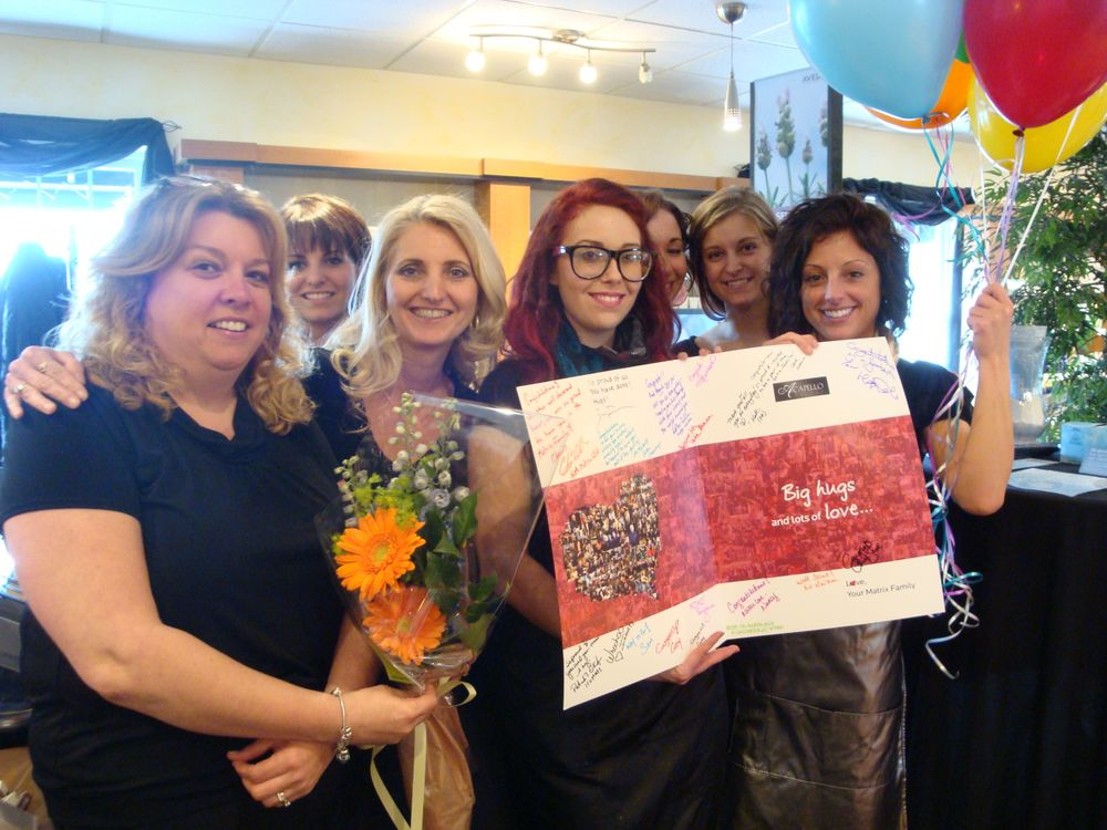 In Scarborough, Maine, the excited staff of Acapello Salons, owned by June Juliano.