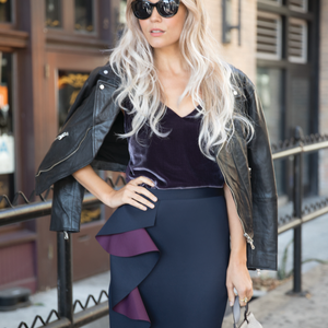 A model is wearing a wig from Revlon Wigs, available in on-trend finishes like this shadow root.