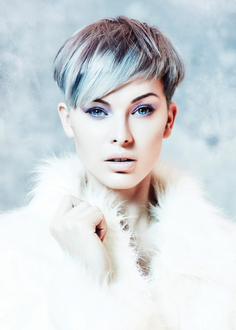 Blue Dream Baby: The icy blue of the model's hair and eyes contrast with the warmth of her fluffy coat to create an inviting look.