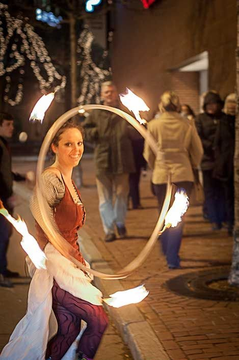 A fire dancer and juggler entertained guests as they waited in line for Cirque du Akari in Portand, Maine. (photo by Francois Gagne.)
