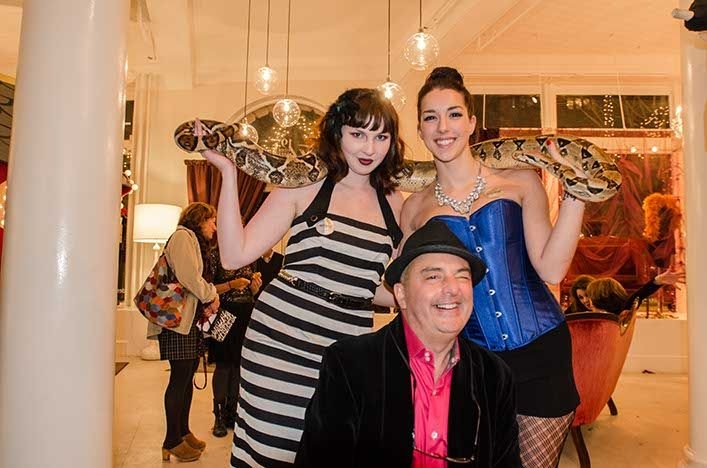 Allan Labos, owner of Akari, with sale assistants Monica and Allison and the snake. The staff all wore Moulin Rouge-inspired outfits. (Photo by Francois Gagne.)