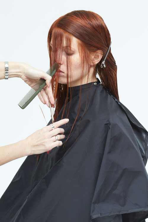 9. Begin the cut at the fringe. Direct forward and cut to blend the fringe with the side.