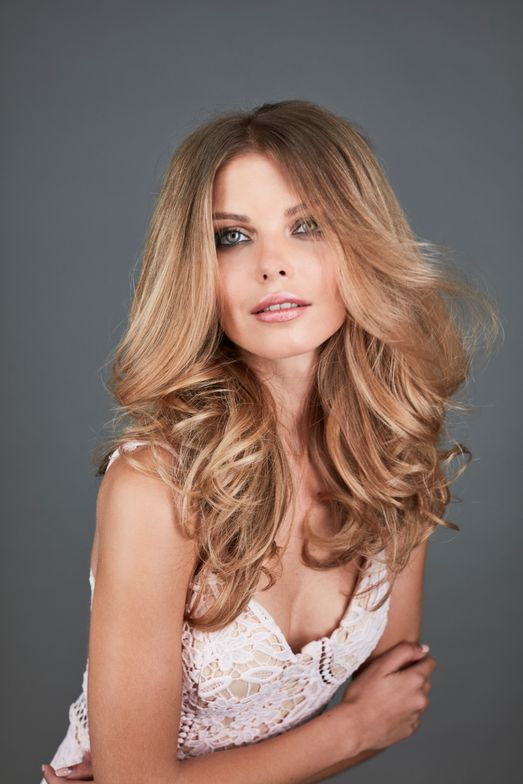 <p><strong>To create a Bardot blowout like this, Michael recommends applying Bombshell section by section to wet hair and combing it through. Then start at the nape with a medium round brush and work in horizontal sections, wrapping the hair around the brush and twisting it before releasing. (Continued.)</strong></p>