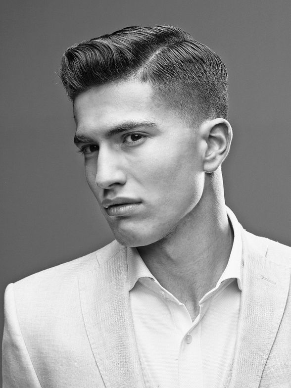 """This image won Jerome Kantner of Germany the title of American Crew All-Star Global Champion 2013-2014. """"Jerome's look exudes classic American Crew with meticulous barbering skills and refined proportions,"""" said Craig Hanson, American Crew Creative Director. """"The wardrobe styling was fresh and masculine, and the art direction perfectly captured an authentic message of the modern man."""""""