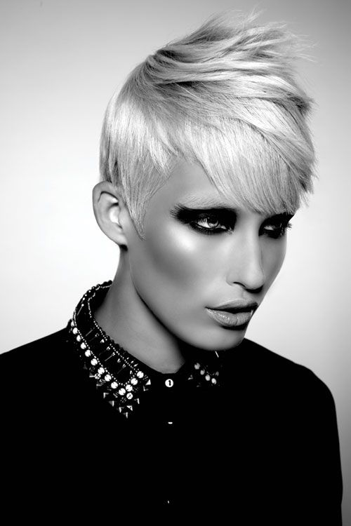 """Style and Structure ::  Androge pushes the boundaries of style while being practical for today's salon client. The looks focus on boyish """"over the ears"""" finishes, with deep side parts."""