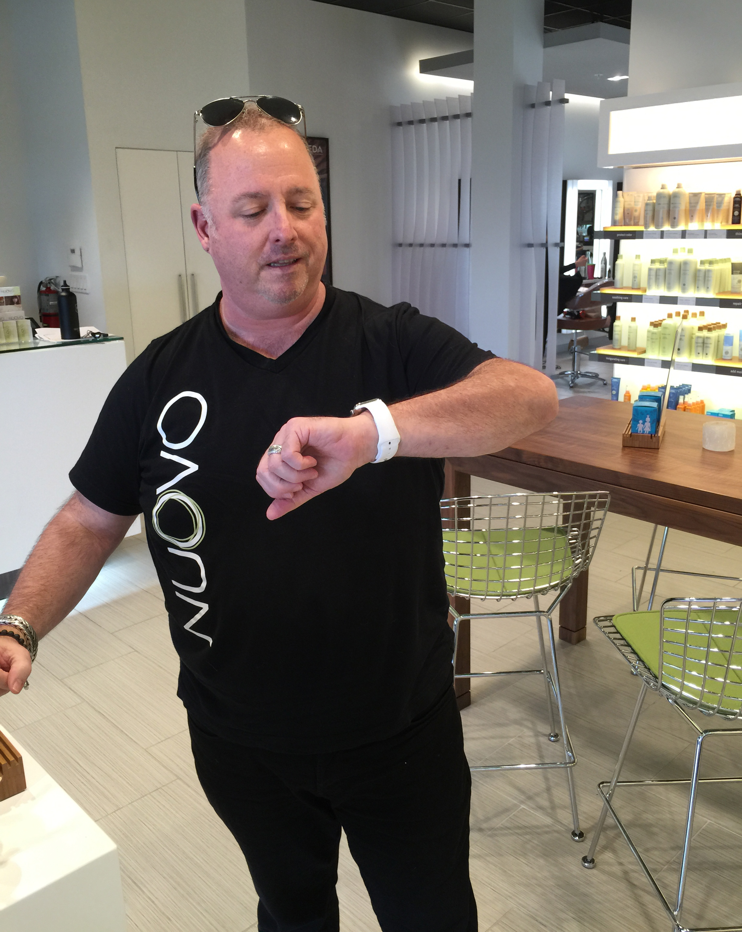 Terry McKee, co-owner of Nuovo Salon Group in Sarasota, Florida, is just learning all the new ways his Apple Watch can help with the management of the salon.